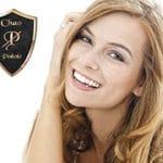 Pinhole Surgical Technique logo next to a blond woman smiling